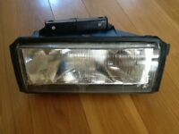 Brand new headlight / headlamp unit for an Austin / MG Montego and used rear light.