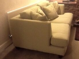 Long settee with cushions plus one other similar