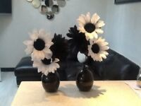 2 black vases with flowers to clear £9.99
