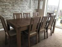 BRAND NEW HARVEYS DARK SOLID OAK WOOD EXTENDING DINING TABLE AND CHAIRS