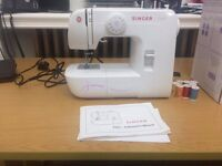 Brand new Singer Sewing machine + Extras!