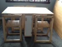 Folding compact space saver dining table and 4 chairs