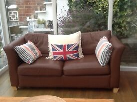 Two seater leather sofa with matching armchair