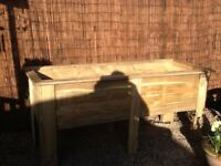 Brand new wooden raised bed for flowers/veg.Bought and constructed but too big for my needs