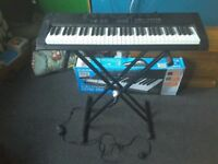 Casio keyboard with box and stand