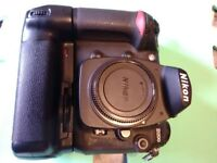 Nikon D200 camera body with battery grip.