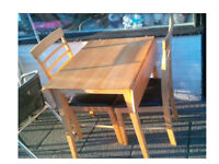 COMPACT PINE DROP LEAF DINING TABLE WITH 2 CHAIRS 24 INCHES WIDE X 30 LONG AND FULLY OPEN 38 INCHES