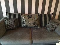 Small 2 large 2 cushioned sofas