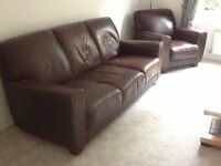 Three seater leather sofa and one arm chair