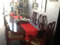 Red mahogany style dining table and chairs