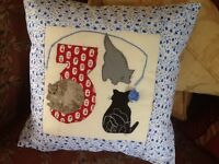 Hand appliqueed child's cushion with the letter 3 with three little kittens on the front