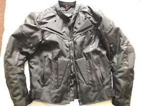 Brand new waterproof motorcycle jacket , size M , armoured