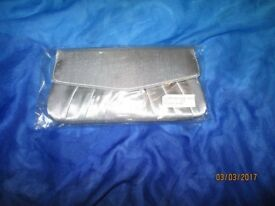 SILVER GREY SILKY CLUTCH BAG BRAND NEW IN PACKET measures 9 x 5 inch