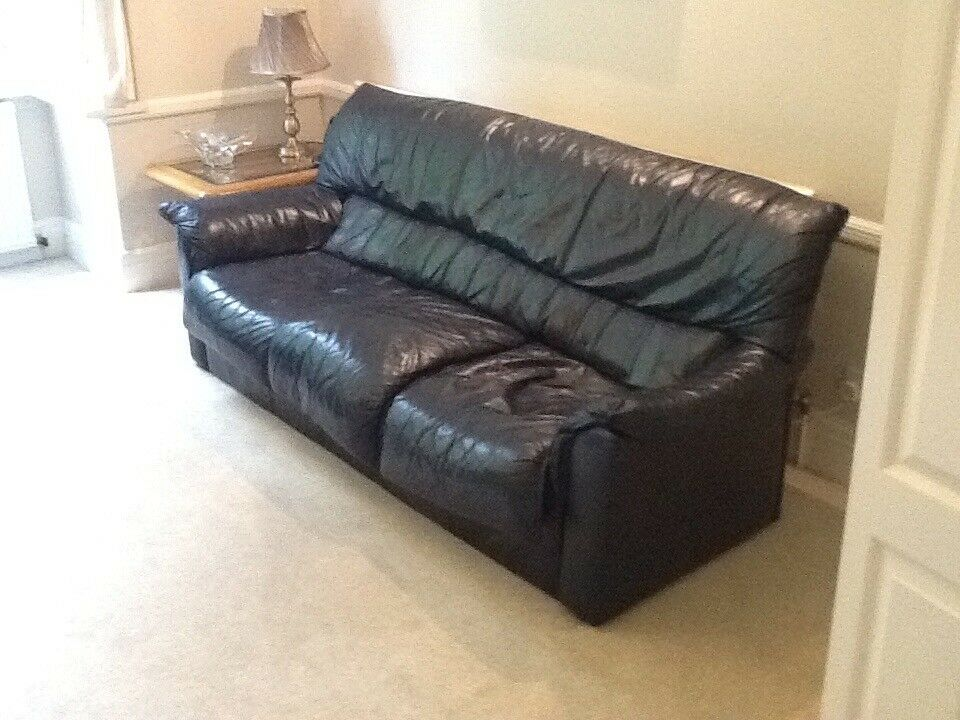 Navy blue grade 3 leather settee & 2 chairs & foot stool