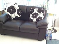 Three seater and two seater black leather settees,good condition.