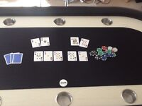 Poker table. A 10 person pro poker table with arc legs. Speed cloth. And 10 cup holders. Chips too.