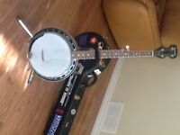 Banjo with hard case.