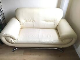 White Colour 2 seater sofa. Excellent condition. Smoke and pet free home. only year old.