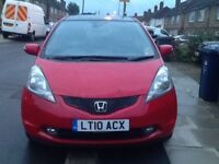 Automatic Red Honda Jazz in excellent condition