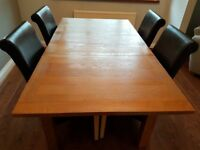wooden dining table with 4 faux leather chairs