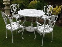 Heavy vintage garden table and chairs