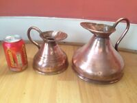Two copper measuring jugs with lead seals.