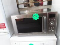 Silver Samsung microwave oven Copley Mill LOW COST MOVES 2nd Hand Furniture STALYBRIDGE SK15 3DN