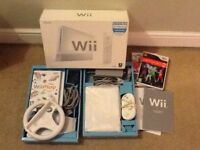 Boxed Nintendo Wii and 5 games plus extras