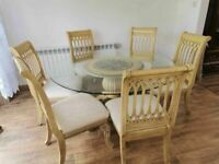 CAN DELIVER - LARGE BEAUTIFUL DINING TABLE WITH GLASS TOP AND 6 CHAIRS WITH CARVED LEGS