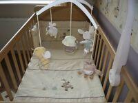 Cot duvet, cot bumper, cot mobile, curtains, holdbacks, rug, light shade and wall clock
