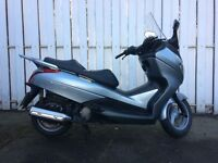 2011 Honda fes125 s-wing scooter.