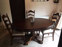 Oval dining room table and six high back chairs