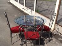 Glass table and 4 chairs further reduction to clear £40