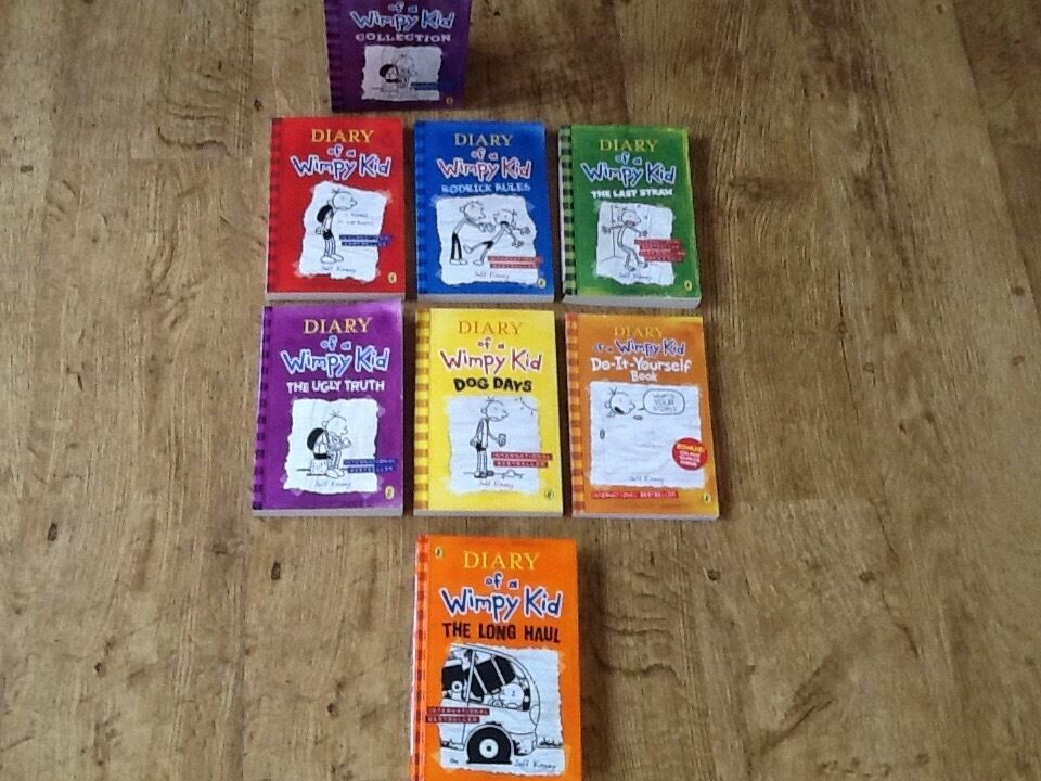 A BOX SET COLLECTION OF DIARY OF A WIMPY KID BOOKS ALSO A HARDBACK EDITION OF LATEST THE LONG HAUL
