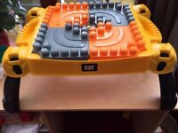 CAT MEGA BLOKS DUPLO TABLE WITH LOTS OF BRICKS UNDER TRAY AS WELL AS AN ADDITION BAG AS SHOWN