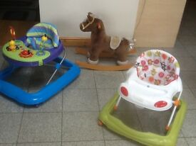 White &green walker and the rocking horse are £10 each;the larger blue walker with console is £20