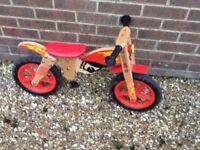 Flaming wooden balance bike ideal 3ish.
