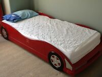 Child's red car bed £125. In excellent condition including foam mattress .