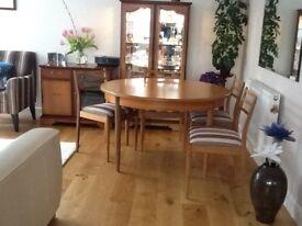 G Plan round teak extending dinning table plus 4 ladder back chairs