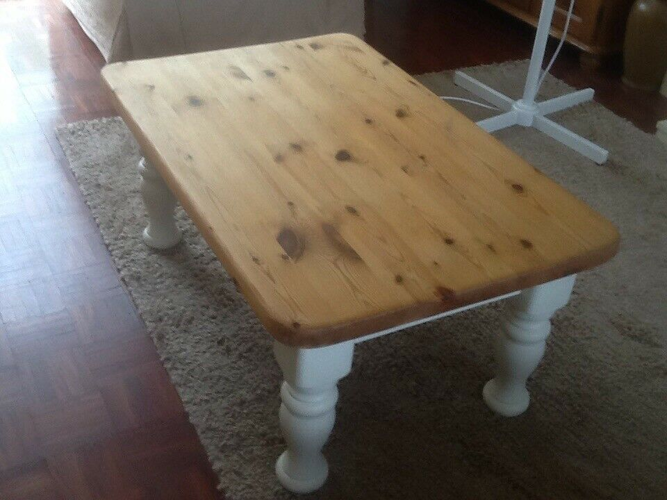 Solid pine coffee table in good used condition. Legs have been painted. Table top solid pine
