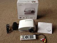 Led HD mini projector with remote brand new boxed