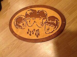Wood carved Beatles sign