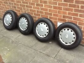 4 x ford four stud steels. With v.good 185/60/13 tyres