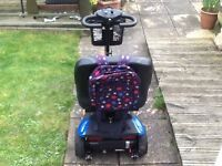 it's blue can travel about 10/12 miles goes uphill easily hardly used comes with charger