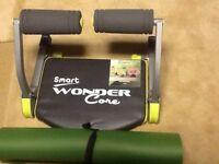 Wonder core exercise machine with work out mat.