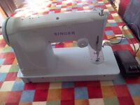 1965 Electric Singer Sewing Machine Model 357 with original accessories - in working order.