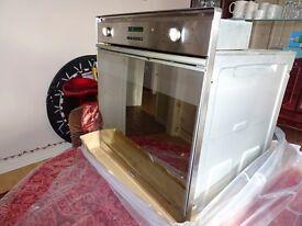 SMEG SE375MFX Integrated Single Fan Oven & Grill, digital display, double glazed door.