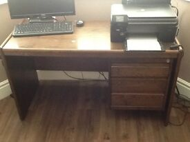 Walnut effect desk with three drawers also selling matching cupboard