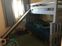 Hand crafted bed with single & 3/4 bed, slide and under bed can be removed 18months old with matress