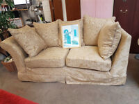 Beige fabric patterned 2 seater sofa with armchair